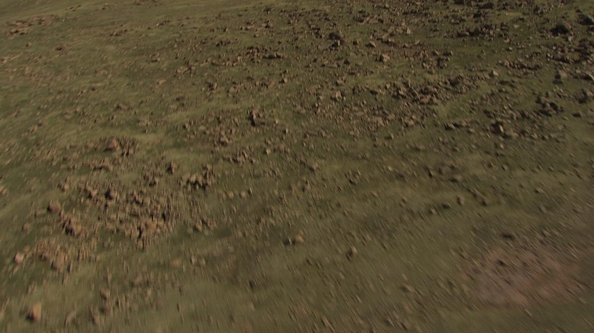 HD stock footage aerial video tilt from a rocky slope to reveal the summit of Pikes Peak, Colorado Aerial Stock Footage | AF0001_000093