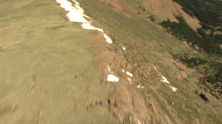 HD stock footage aerial video of a bird's eye view of the mountain summit, reveal road winding up to Pikes Peak, Colorado Aerial Stock Footage | AF0001_000095
