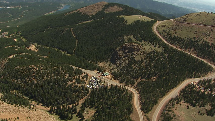 HD stock footage aerial video follow the winding road down the side of Pikes Peak, Colorado Aerial Stock Footage | AF0001_000096