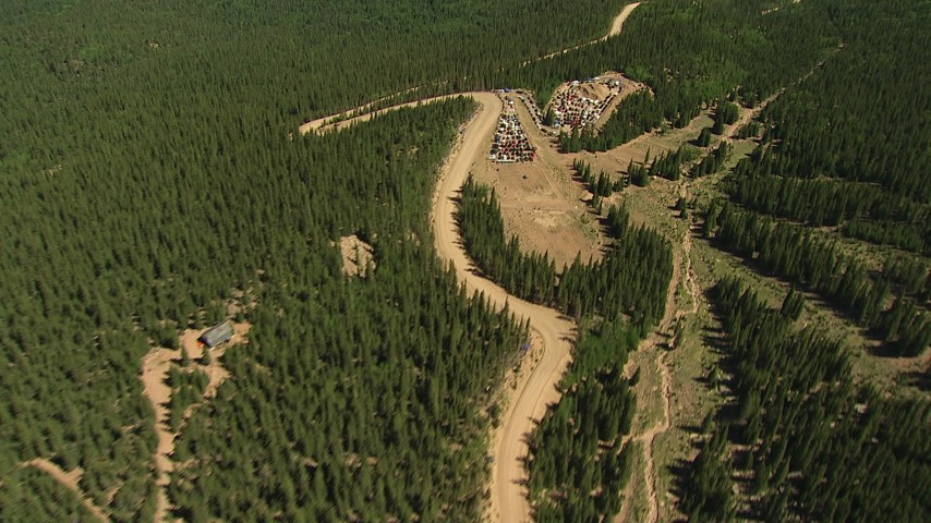 HD stock footage aerial video of a dirt road winding through forest and foothills of Pikes Peak, Colorado Aerial Stock Footage | AF0001_000097