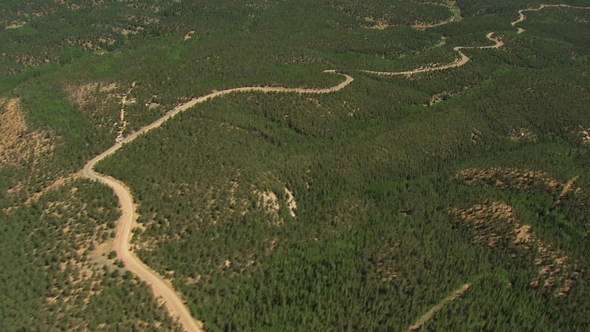 HD stock footage aerial video tilt from a forest road to reveal South and North Catamount Reservoirs, Pikes Peak, Colorado Aerial Stock Footage | AF0001_000098