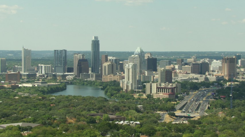 Tall skyscrapers overlooking Lady Bird Lake, Downtown Austin, Texas Aerial Stock Footage | AF0001_000102