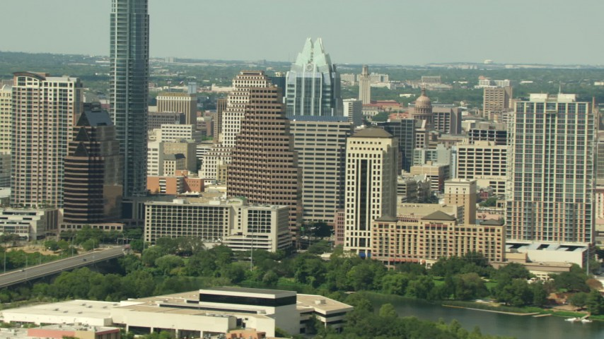 HD stock footage aerial video flyby skyscrapers to reveal the Texas State Capitol in Downtown Austin, Texas Aerial Stock Footage | AF0001_000103