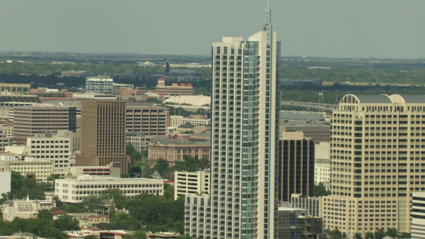 HD stock footage aerial video flyby skyscrapers to reveal the Texas State Capitol in Downtown Austin, Texas Aerial Stock Footage | AF0001_000104