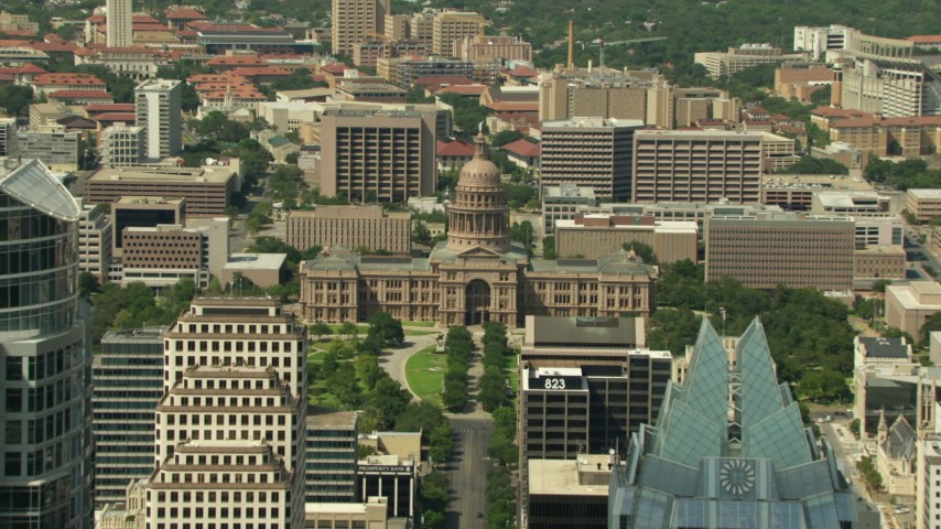 HD stock footage aerial video tilt from Congress Avenue Bridge to reveal skyscrapers and Texas State Capitol, Downtown Austin, Texas Aerial Stock Footage | AF0001_000108