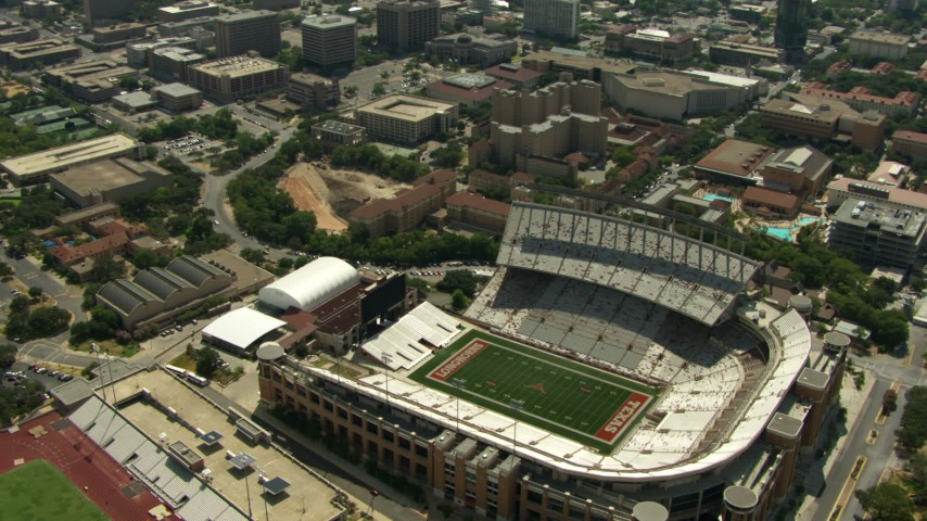 Texas Memorial Stadium and University of Texas campus, reveal Downtown Austin, Texas Aerial Stock Footage | AF0001_000111