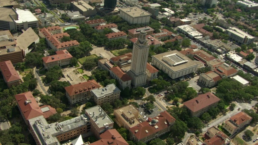 Tilt to bird's eye of Garrison Hall and Main Building at the University of Texas at Austin, Texas Aerial Stock Footage | AF0001_000112