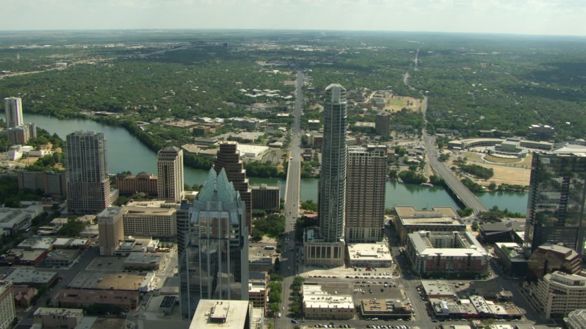 Tilt to bird's eye view of Frost Bank Tower and North Congress Ave, Downtown Austin, Texas Aerial Stock Footage | AF0001_000114