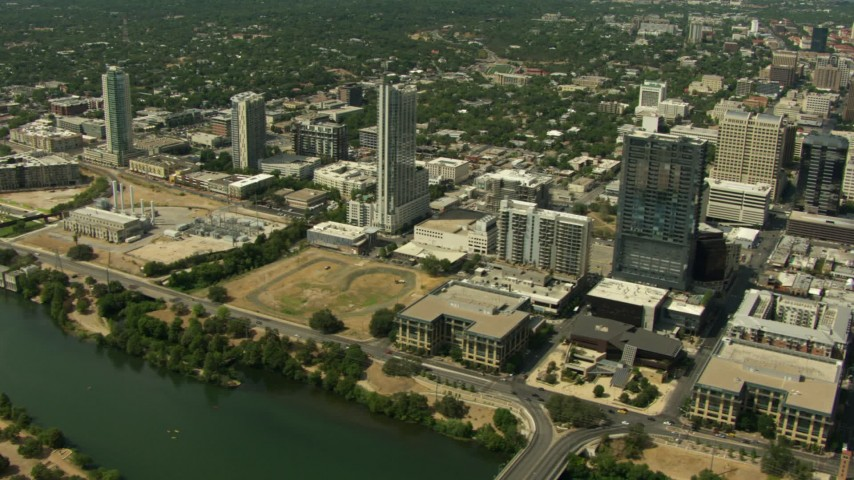 Downtown skyscrapers and power plant near Lady Bird Lake, Downtown Austin, Texas Aerial Stock Footage | AF0001_000116