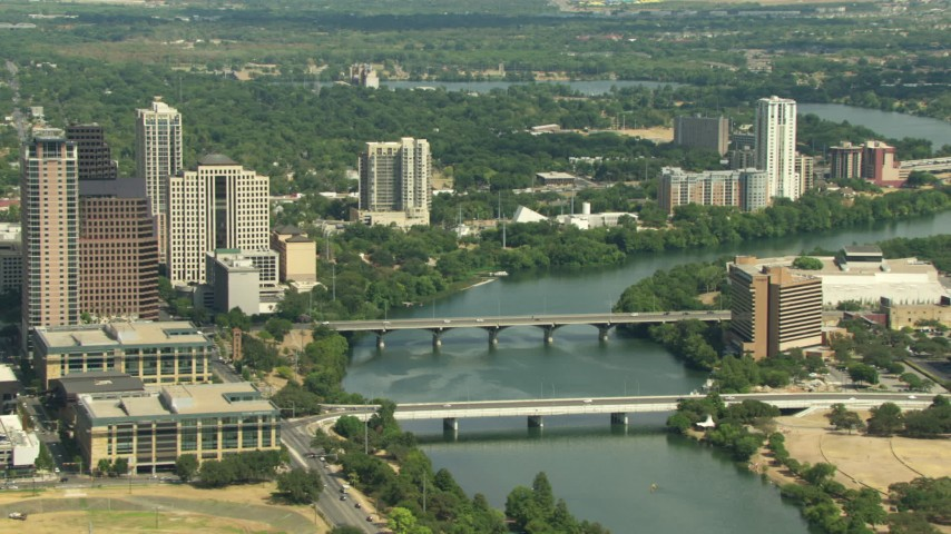 Congress Avenue and 1st Street Bridges and skyscrapers in Downtown Austin, Texas Aerial Stock Footage | AF0001_000118