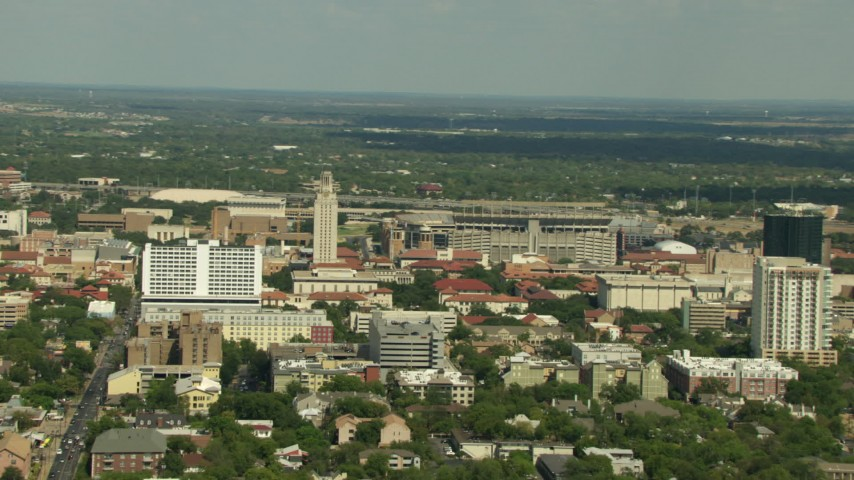 Flying by the University of Texas campus in Austin, Texas Aerial Stock Footage | AF0001_000119
