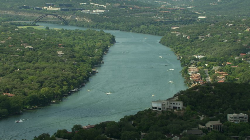 Approach Lake Austin with boats in Austin, Texas Aerial Stock Footage | AF0001_000120