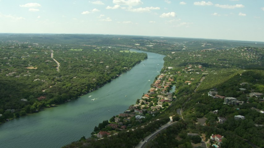 HD stock footage aerial video flyby waterfront homes on Lake Austin near the Pennybacker Bridge, Austin, Texas Aerial Stock Footage | AF0001_000121