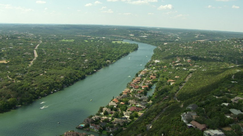 HD stock footage aerial video flyby waterfront homes on Lake Austin near the Pennybacker Bridge, Austin, Texas Aerial Stock Footage   AF0001_000121