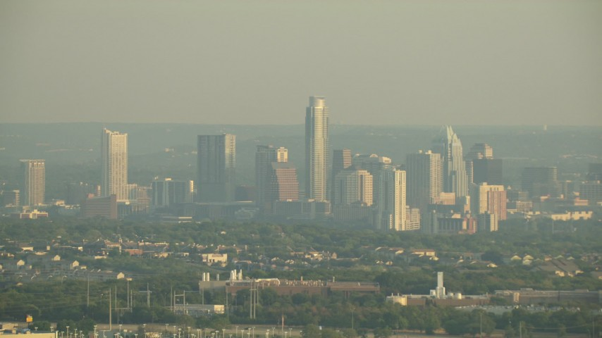 HD stock footage aerial video of the city skyline on a hazy day, Downtown Austin, Texas Aerial Stock Footage | AF0001_000125