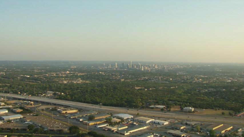 HD stock footage aerial video approach the 71 freeway with a view of Downtown Austin, Texas Aerial Stock Footage | AF0001_000127