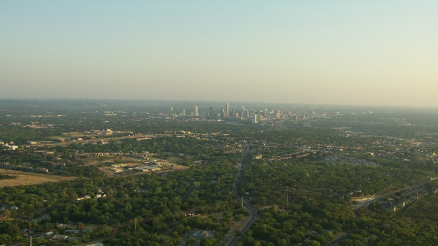 Approach a school with the city skyline in the background, Downtown Austin, Texas Aerial Stock Footage | AF0001_000128