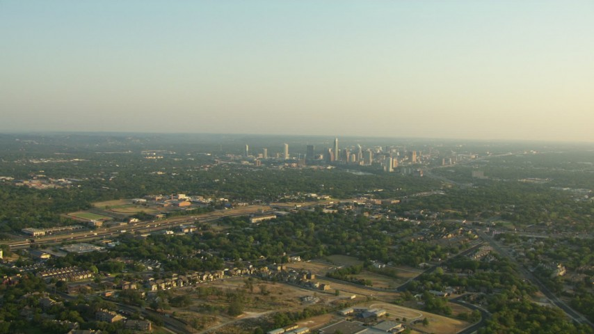 HD stock footage aerial video of 290 freeway near high school, zoom on city skyline, Downtown Austin, Texas Aerial Stock Footage | AF0001_000129