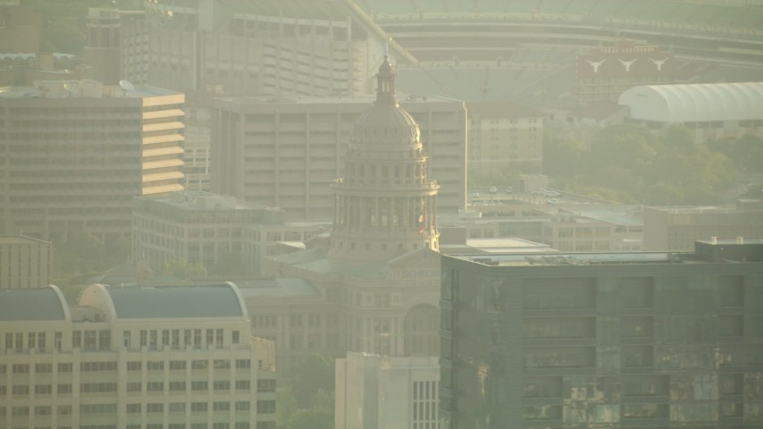 HD stock footage aerial video tilt from Congress Avenue Bridge to reveal skyscrapers and Texas State Capitol, Downtown Austin, Texas Aerial Stock Footage | AF0001_000131