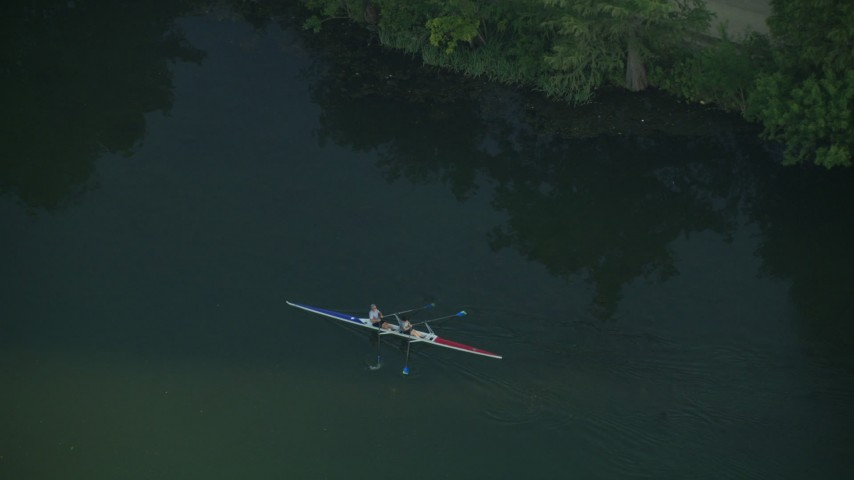 Tracking kayakers on Lady Bird Lake, Austin, Texas Aerial Stock Footage | AF0001_000134