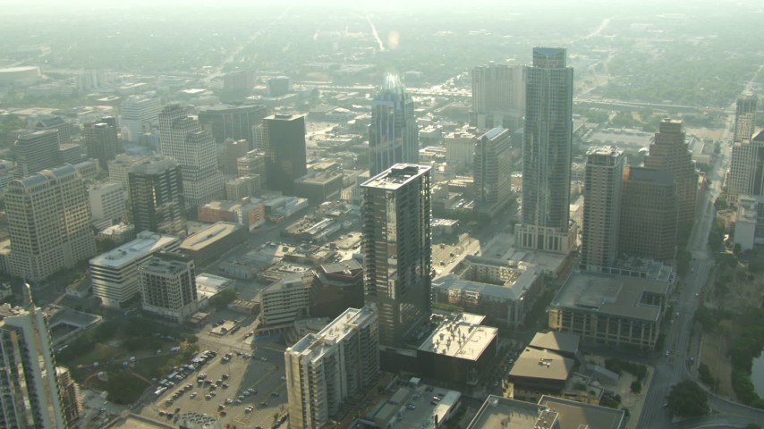 Flying by skyscrapers in Downtown Austin, Texas Aerial Stock Footage | AF0001_000139
