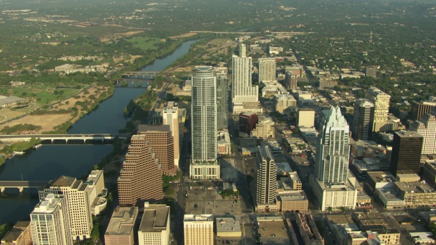 Skyscrapers by bridges over Lady Bird Lake in Downtown Austin, Texas Aerial Stock Footage | AF0001_000141