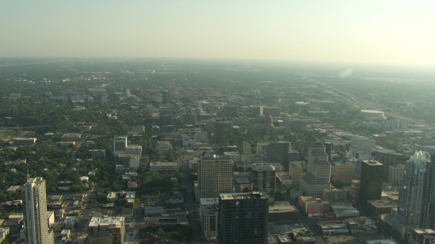 HD stock footage aerial video of a view across city buildings in Downtown Austin, Texas Aerial Stock Footage | AF0001_000148