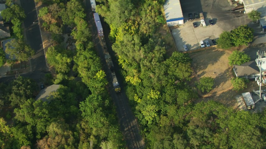 Bird's eye view of a running train in Austin, Texas Aerial Stock Footage | AF0001_000149