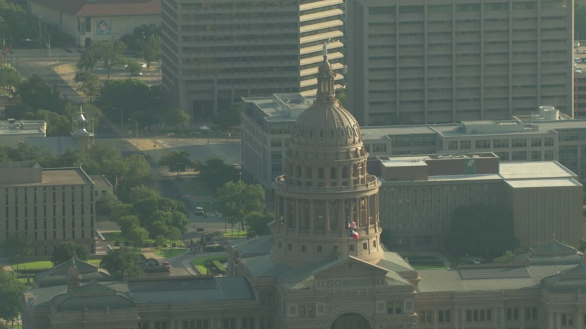HD stock footage aerial video approach the Texas State Capitol dome in Downtown Austin, Texas Aerial Stock Footage | AF0001_000151