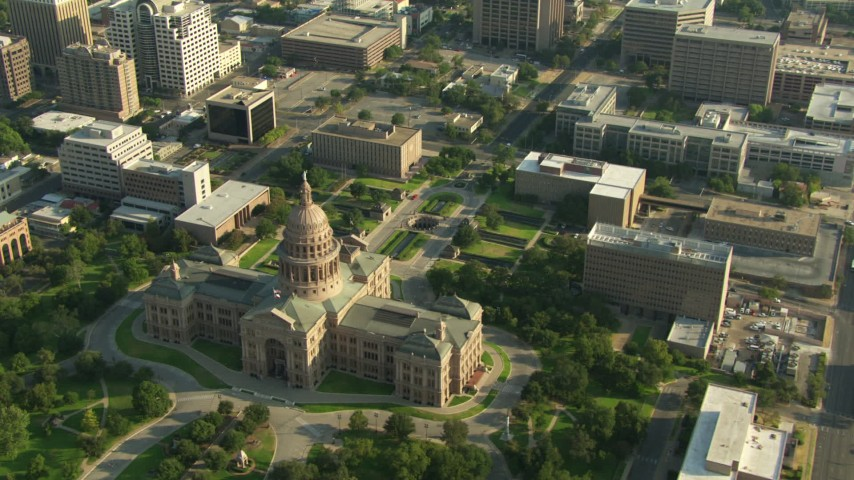 Texas State Capitol and government buildings in Downtown Austin, Texas Aerial Stock Footage | AF0001_000152