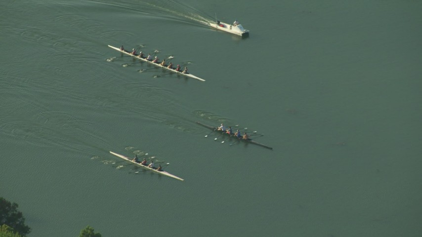 HD stock footage aerial video of rowers practicing on Lady Bird Lake in Austin, Texas Aerial Stock Footage | AF0001_000156