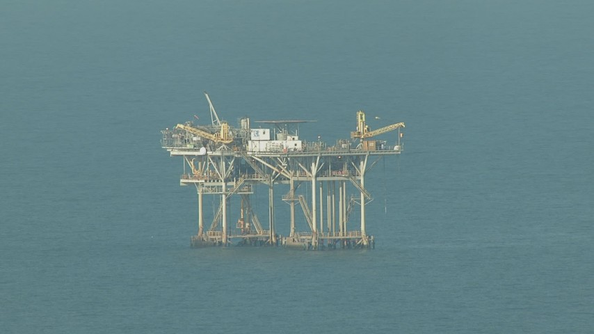HD stock footage aerial video of flying by an oil platform in the Gulf of Mexico Aerial Stock Footage | AF0001_000168