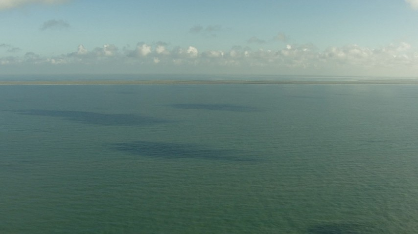 Fly over the Gulf of Mexico to approach the Matagorda Peninsula, Texas Aerial Stock Footage | AF0001_000169