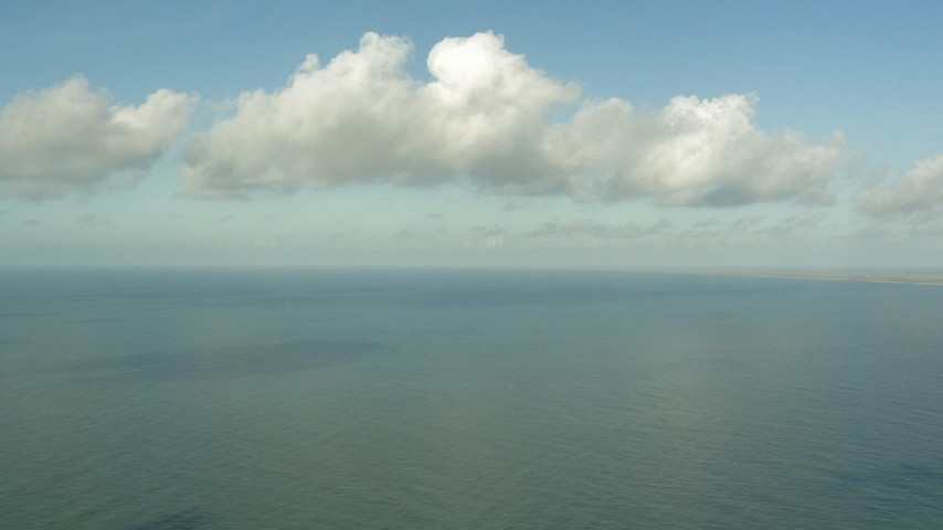 HD stock footage aerial video of flying over the Gulf of Mexico with a view of clouds near Matagorda Peninsula, Texas Aerial Stock Footage   AF0001_000170