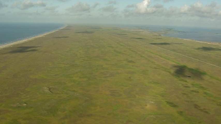Matagorda Peninsula seen while flying over the Gulf of Mexico, Texas Aerial Stock Footage | AF0001_000172