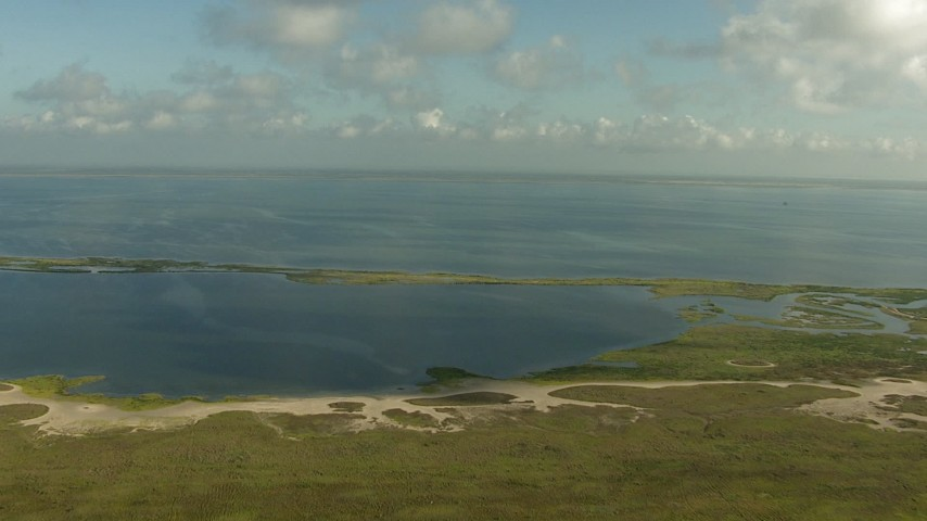 HD stock footage aerial video approach Matagorda Bay from the Matagorda Peninsula, Texas Aerial Stock Footage | AF0001_000173