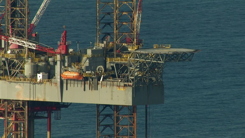 Flyby an oil derrick in the Gulf of Mexico Aerial Stock Footage | AF0001_000183