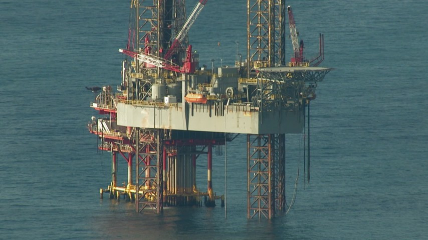 An offshore oil rig in the Gulf of Mexico Aerial Stock Footage | AF0001_000184