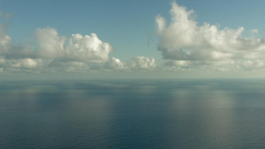 Fly over the Gulf of Mexico and pan across the water Aerial Stock Footage | AF0001_000185