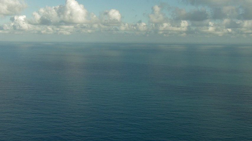 Flyby open sea beneath low clouds in the Gulf of Mexico Aerial Stock Footage | AF0001_000187