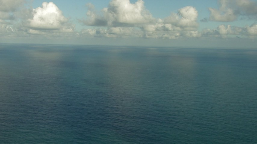 HD stock footage aerial video of a view of the open water beneath low clouds, Gulf of Mexico Aerial Stock Footage | AF0001_000188