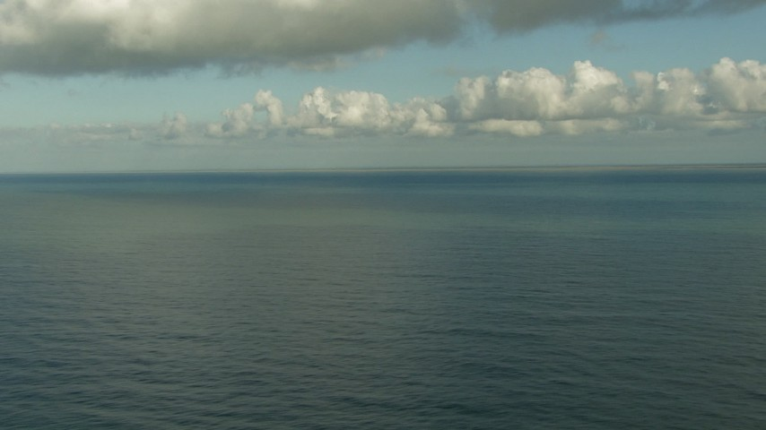 HD stock footage aerial video pan across the water and descend low over the Gulf of Mexico, with the Matagorda Peninsula in the background, Texas Aerial Stock Footage   AF0001_000194