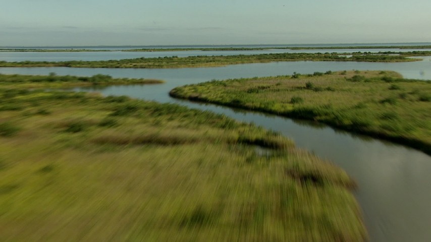 HD stock footage aerial video of flying low over marsh and wetland on the Matagorda Peninsula, Texas Aerial Stock Footage | AF0001_000199