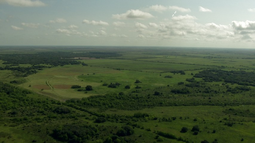 HD stock footage aerial video of flying over farmland and a country road, Danevang, Texas Aerial Stock Footage | AF0001_000223