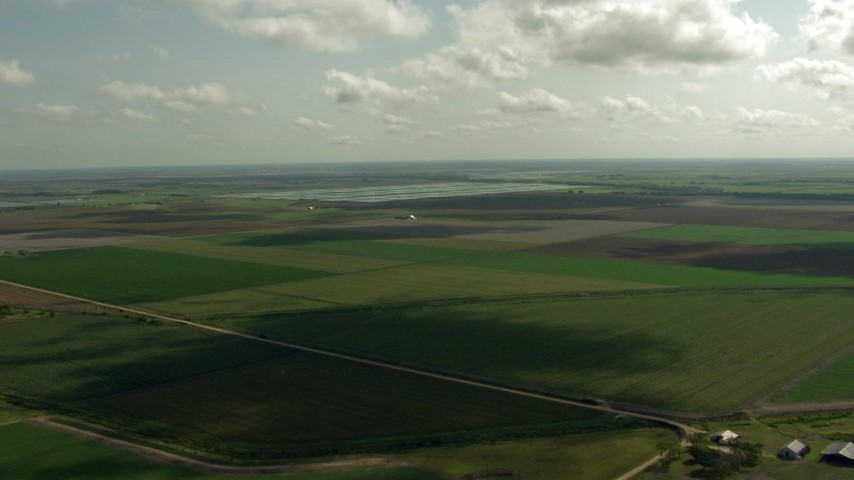 HD stock footage aerial video of flying over farmland to approach fish farms, Danevang, Texas Aerial Stock Footage | AF0001_000224