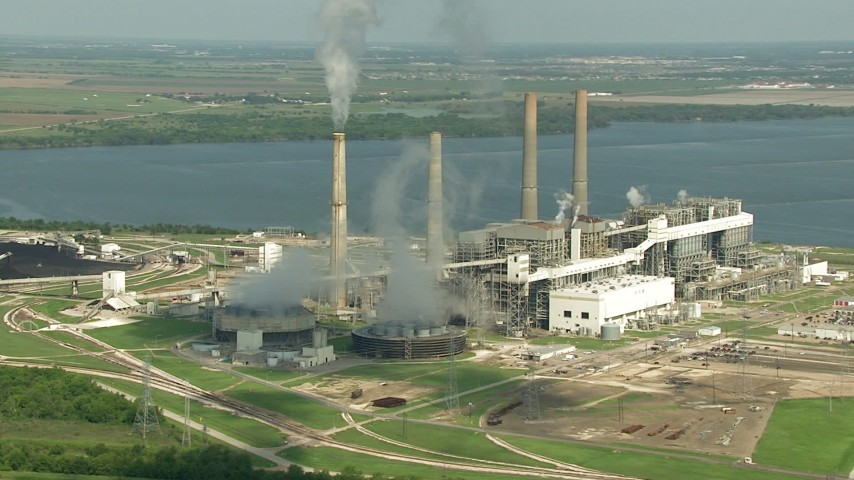 HD stock footage aerial video zoom to a wider view of WA Parish Generating Station and smoke stacks at Smithers Lake, Texas Aerial Stock Footage | AF0001_000243