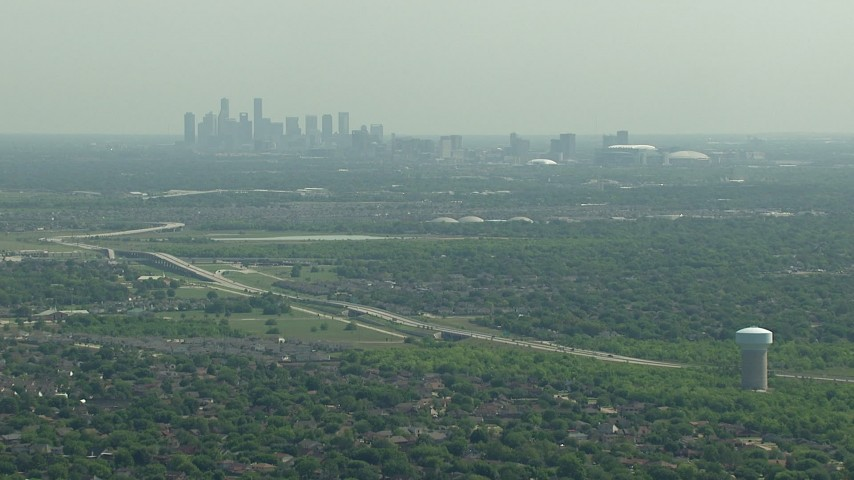 Approach Fort Bend Parkway with a view of the skyline of Downtown Houston, Texas Aerial Stock Footage | AF0001_000247