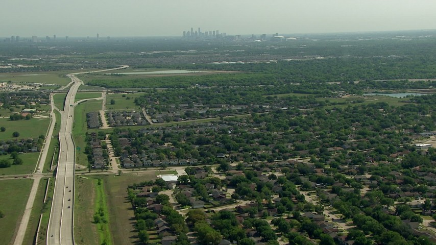 HD stock footage aerial video of flying over the Fort Bend Parkway and suburban neighborhoods in Houston, Texas Aerial Stock Footage | AF0001_000248