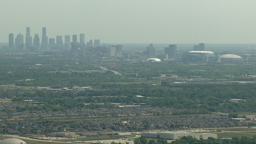 The city skyline, NRG Stadium, and the Houston Astrodome, Downtown Houston, Texas Aerial Stock Footage | AF0001_000249