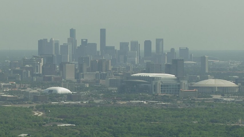 HD stock footage aerial video of the city skyline, NRG Stadium, reveal Houston Astrodome in Downtown Houston, Texas Aerial Stock Footage | AF0001_000251